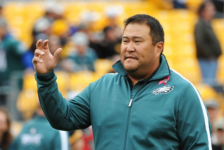 Offensive line assistant Eugene Chung of the Philadelphia Eagles looks on from the field during pregame warmup on Oct. 7, 2012, in Pittsburgh, Pa.