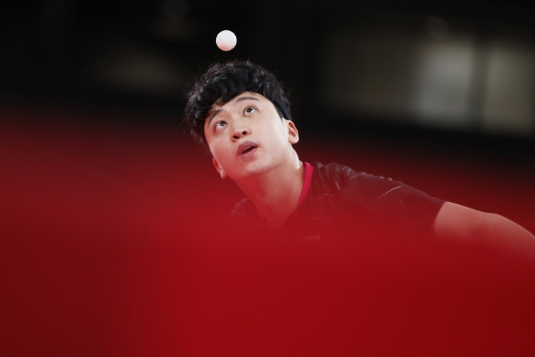 Jeoung Youngsik of Team South Korea serves the ball during his Men's Singles Quarterfinals table tennis match against Greece's Panagiotis Gionis at the Olympics in Tokyo on July 28, 2021.