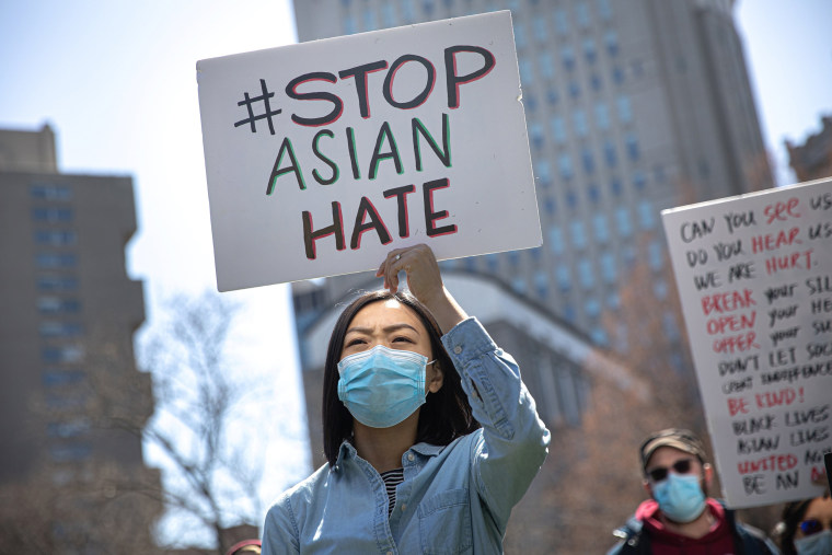 Image: People participate in a Stop Asian Hate rally at Columbus Park in New York