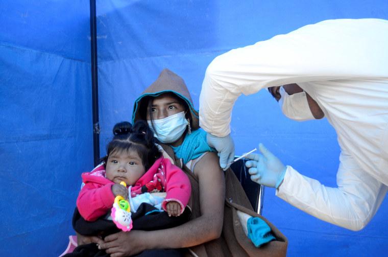 Image: Bolivia's indigenous raise concern over vaccines shortfall, in Uru Chipaya