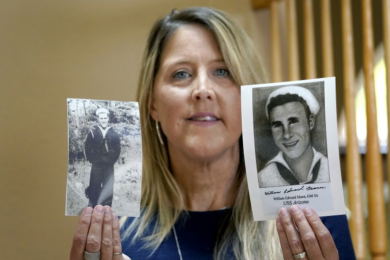 Image: Teri Mann Whyatt displays photos of her uncle, William Edward Mann, who died on the USS Arizona during the bombing of Pearl Harbor, at her home on July 14, 2021, in Newcastle, Wash.