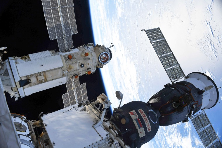 The Nauka Multipurpose Laboratory Module, left, is docked to the International Space Station next to the Soyuz MS-18 spacecraft on July 29, 2021.