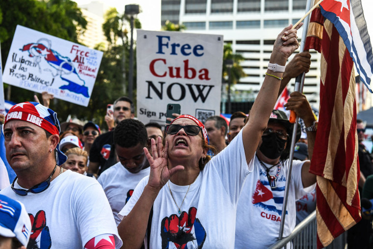 """Protesters hold """"Free Cuba"""" signs during a rally in Miami on July 31, 2021."""