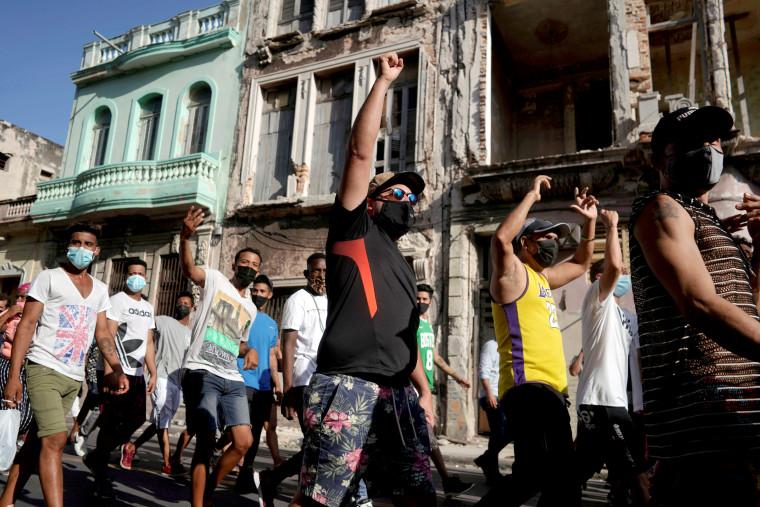 Image: People shout slogans during a demonstration in Havana on July 11, 2021.