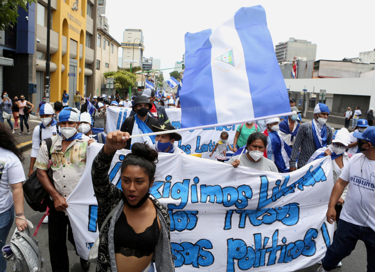 """Image: Nicaraguans exiled in Costa Rica take part in a march named """"Nicaragua no estas sola"""" (Nicaragua you're not alone), in San Jose, Costa Rica"""