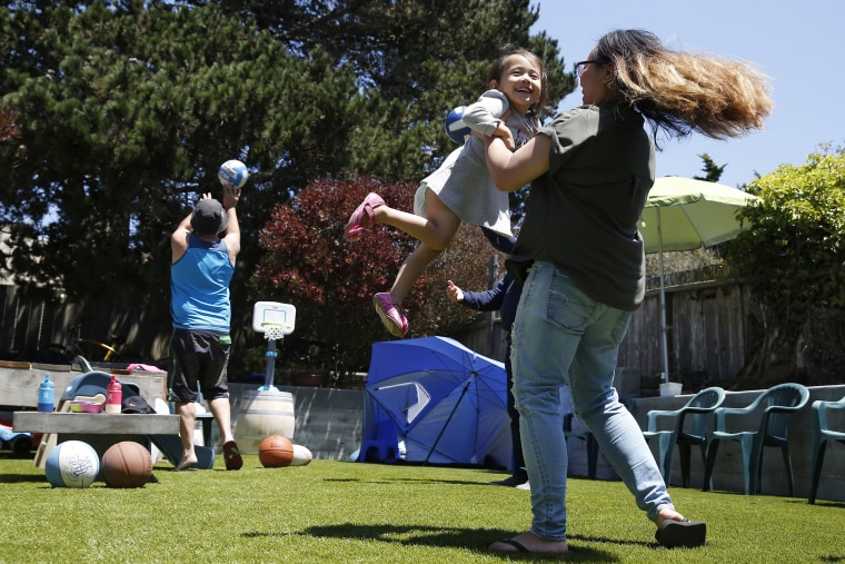 A family celebrates Independence Day during a barbecue in their backyard on July 4, 2020 in San Francisco.