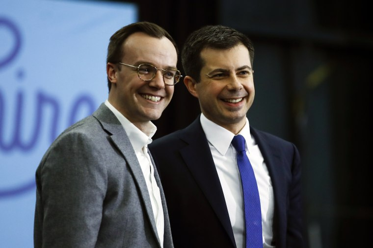 Former South Bend, Ind., Mayor Pete Buttigieg and his husband Chasten Buttigieg acknowledge the audience at the end of a campaign event on Feb. 10, 2020, in Milford, N.H.