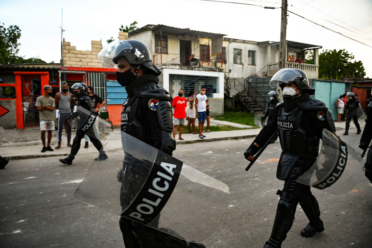 Riot police walk the streets after an antigovernmental demonstration in Havana on July 12, 2021.