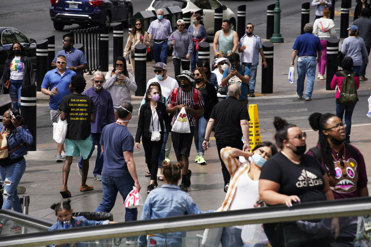 Pedestrians walk along the Las Vegas Strip on April 27, 2021.