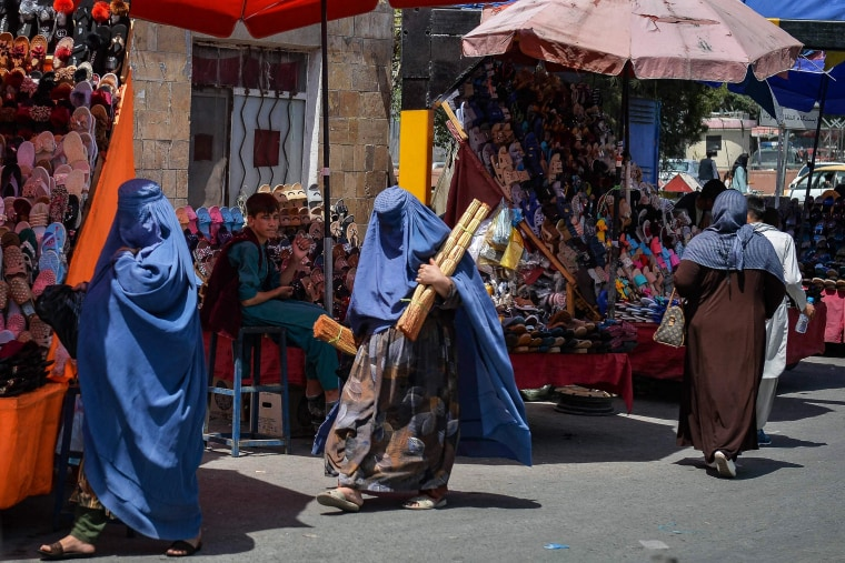 Afghan women shop at a market in Kabul on Aug. 23, 2021.
