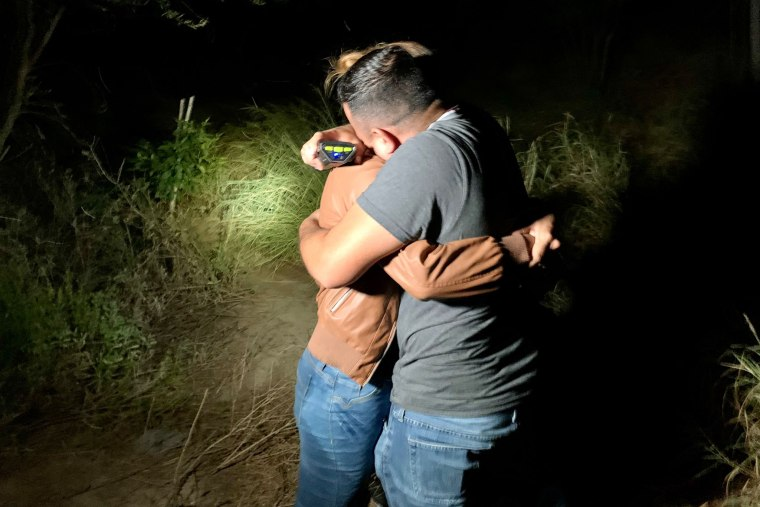 Honduran immigrant Edín Galeano hugs his partner after finding her on the bank of the Rio Grande, in Texas, after more than five years without seeing her.