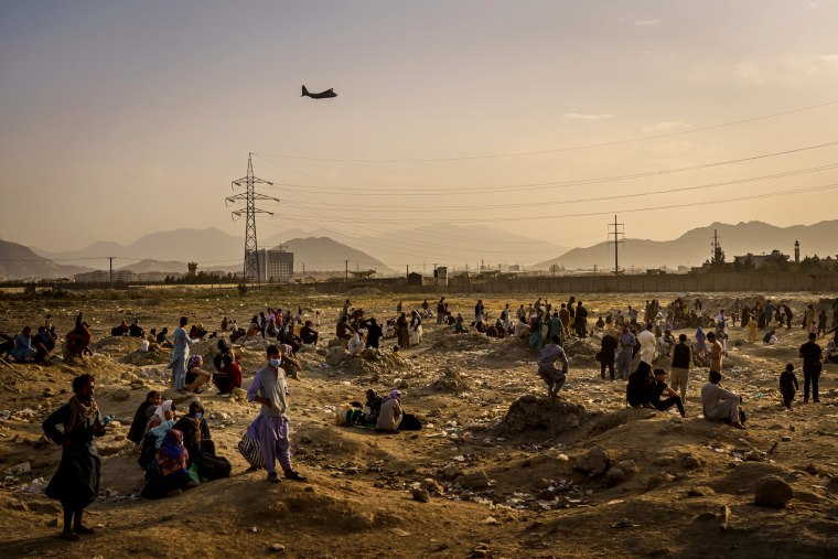 A military transport plane takes off while Afghans who cannot evacuate are stranded in Kabul on Aug. 23, 2021.