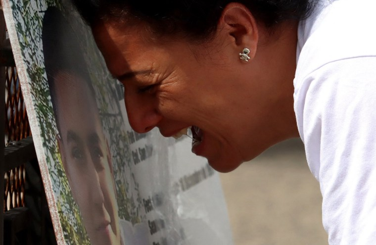 Image: A woman cries at the  Glorieta de los Desaparecidos monument in Guadalajara, state of Jalisco, Mexico, on Aug. 29, 2021. The monument displays photographs and data of missing persons.