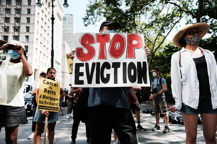 Activists hold a protest against evictions near City Hall on Aug. 11, 2021, in New York.