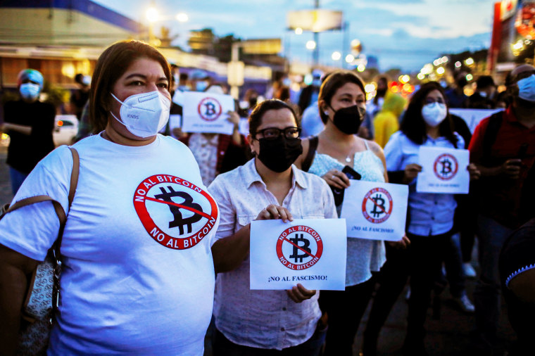 People protest against the use of Bitcoin as legal tender in San Salvador, El Salvador, on Sept. 1, 2021.