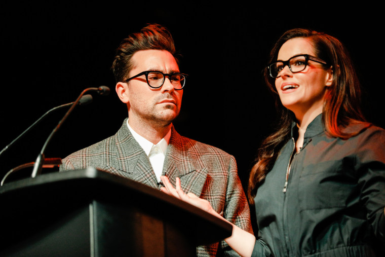 Dan Levy and Emily Hampshire speak at a benefit on April 12, 2018, in Toronto, Canada.