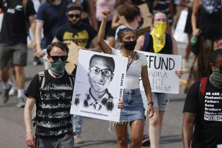 Demonstrators march over the death of Elijah McClain in Aurora, Colo., on June 27, 2020.