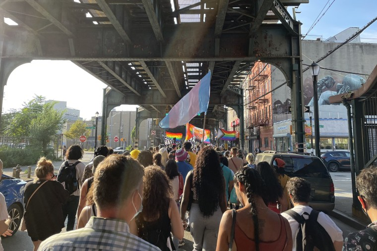 Protesters march in Brooklyn, New York, on Wednesday for two men who police said were stabbed with a glass bottle and a screwdriver.