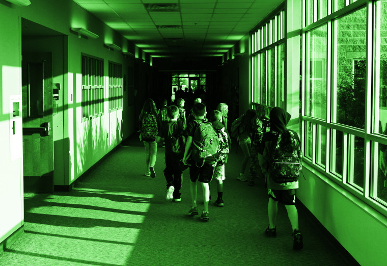 Students head to class at West Ridge Elementary School in Thornton, Colo.,on Aug. 12.