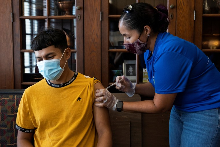 Image: Dr. Melissa Pluguez Moldavskiy, Co-Medical Director of Unidos Contra COVID, administers a vaccine during an outreach event for the Latino community in Upper Darby, Penn., on Aug. 22, 2021.
