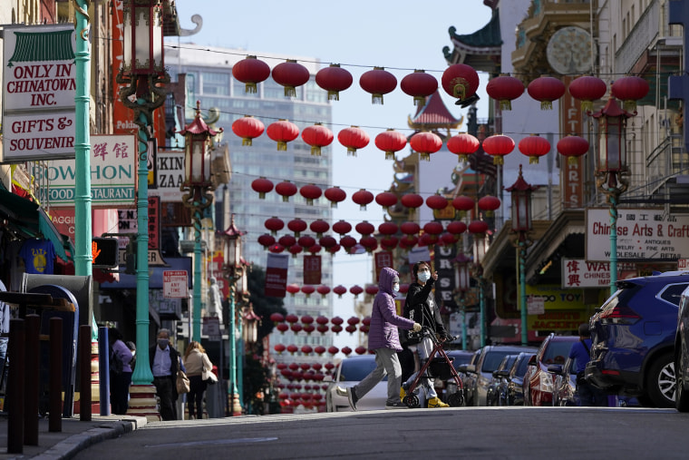 People cross Grant Avenue in Chinatown in San Francisco on March 25.