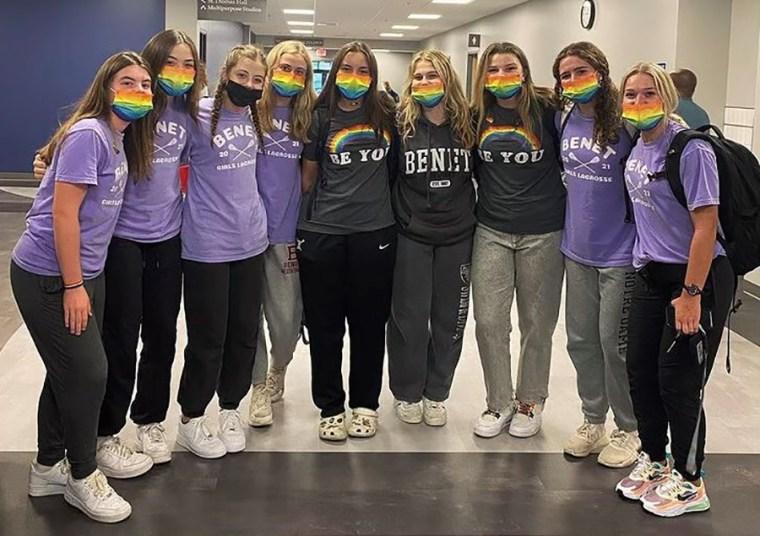 Image: Members of the Benet Academy lacrosse team wear rainbow Pride masks in support of Coach Amanda Kammes.