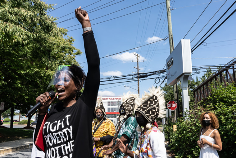 A demonstrator speaks in support of the Moses African Cemetery in Bethesda. Md., on Sept. 10.