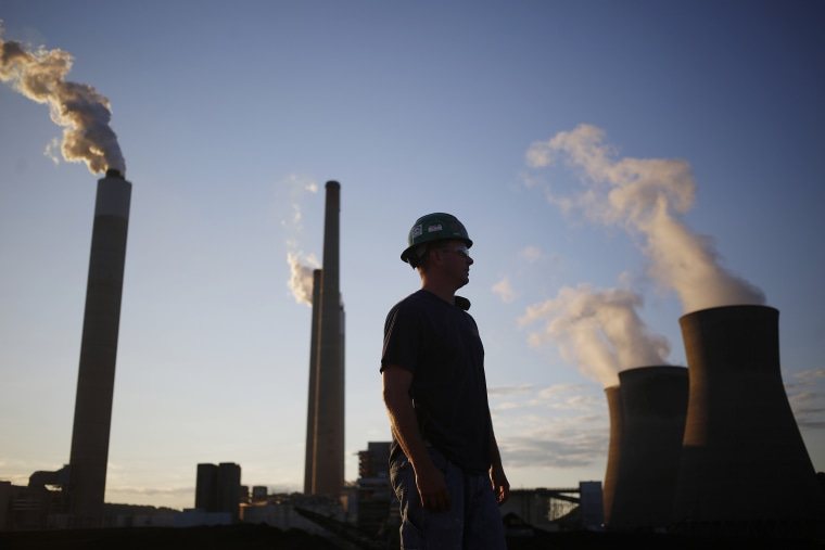 Image: A worker stands in a coal yard in Winfield, W.V., on July 18, 2018.