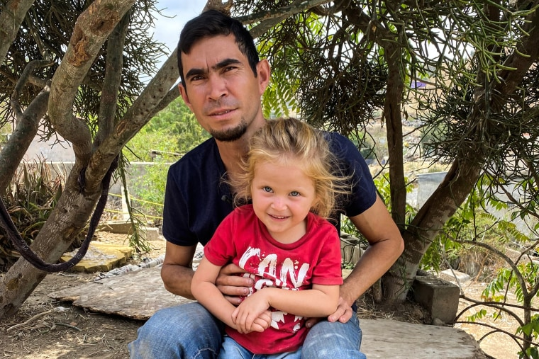 David Sanabria and his daughter, Ximena, during their stay at the Iglesia Embajadores de Jesús shelter in Tijuana, Baja California, Mexico in July 2021.