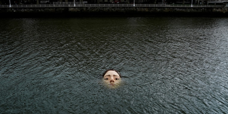 A fibreglass sculpture entitled 'Bihar' is submerged in the Nervion river in Bilbao
