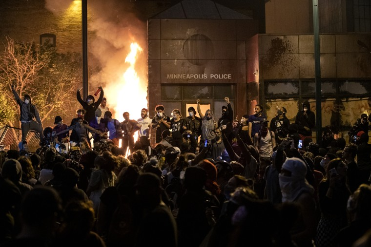 The Minneapolis Third Police Precinct is set on fire on May 28, 2020, during a third night of protests following the death of George Floyd while in Minneapolis police custody.