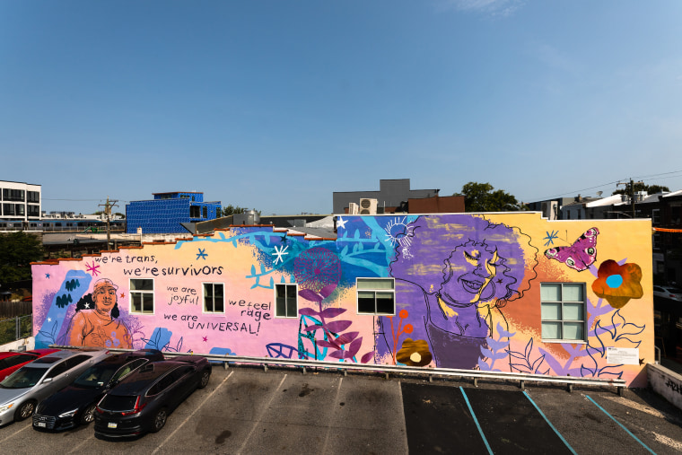 """The """"We Are Universal"""" mural by the City of Philadelphia Mural Arts Program and artist Kah Yangni on the Cake Life Bake Shop."""