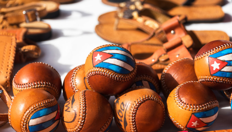 Baseballs with Cuban flags painted on them are displayed as souvenirs in Cuba on Dec. 21, 2017.