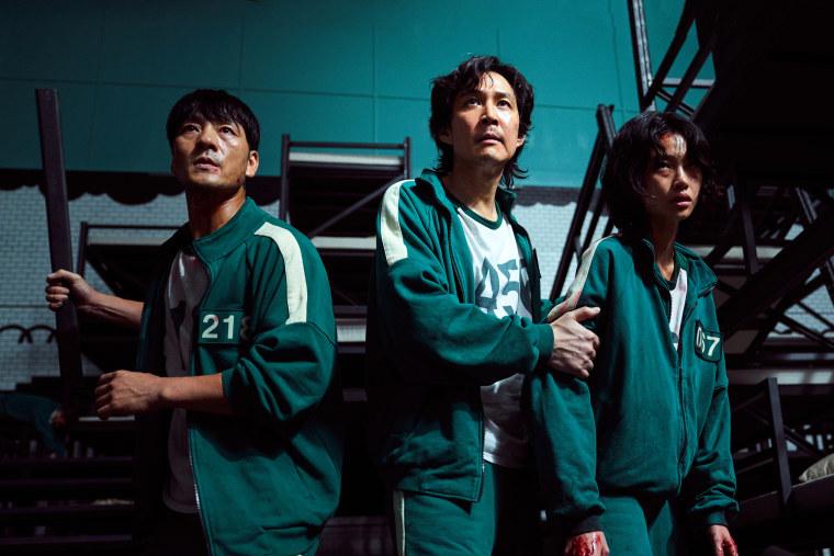 "Park Hae Soo as Cho Sang-Woo, left, Lee Jung-jae as Seong Gi-Hun, center, and Jung Ho-yeon as Kang Sae Byeok in Netflix's ""Squid Game."""