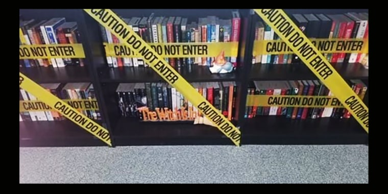 Image: A Carroll ISD teacher hung caution tape in front of the books in a classroom after the new policy was circulated.