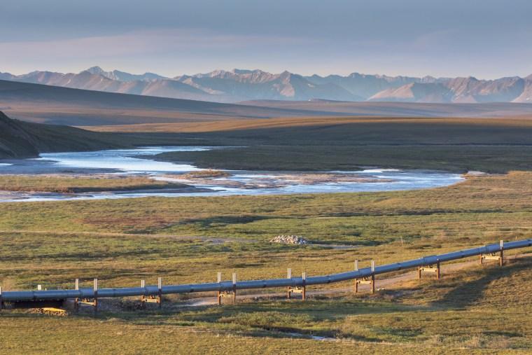 The Trans-Alaska pipeline along the Sagavanirktok River in Brooks Range, Alaska.