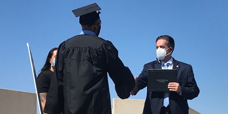 One prisoner receives his diploma at the California State Prison in Lancaster.