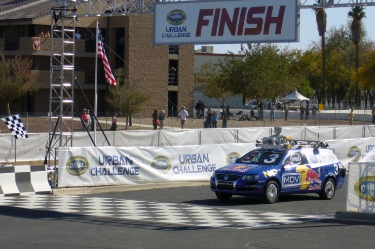 Junior, a 2006 Volkswagen Passat, heavily modified and robotized by a team of Stanford University, crosses the finish line in first place of the DARPA Grand Challenge on Nov. 3, 2007, in Victorville, Calif.