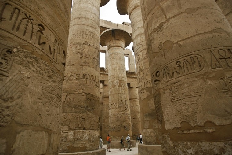Stone columns decorated with hieroglyphs are one of the many draws at the Karnak temple complex in Luxor, Egypt.