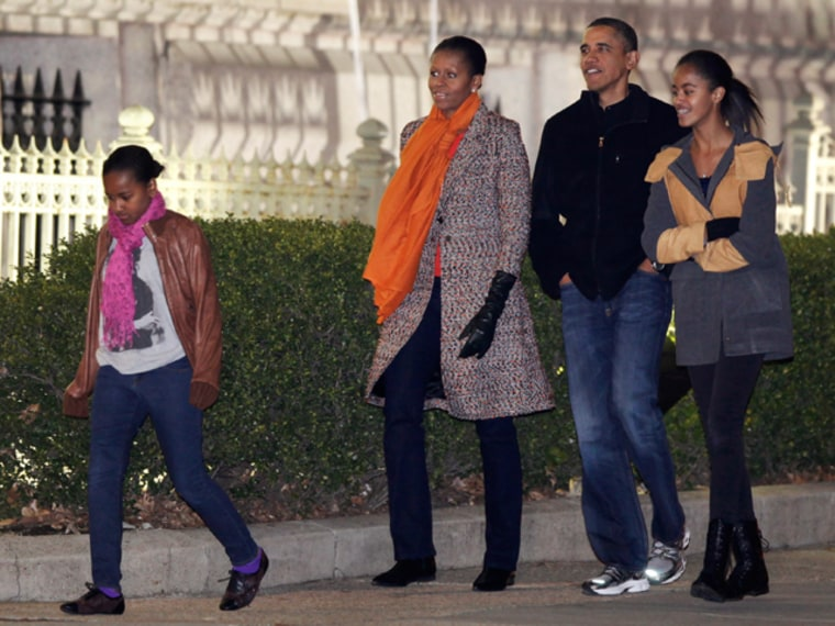 President Obama with first lady Michelle and daughters Malia (right) and Sasha walk to the Corcoran Gallery of Art in Washington on Jan. 29.