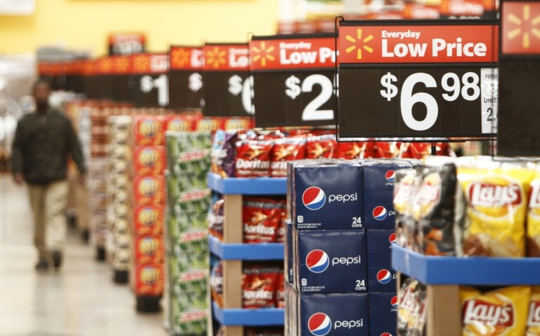 A worker walks through a new Wal-Mart store in Chicago in this January 2012 file photo. Wal-Mart got low ranks in a Consumer Reports survey of favorite grocery stores.