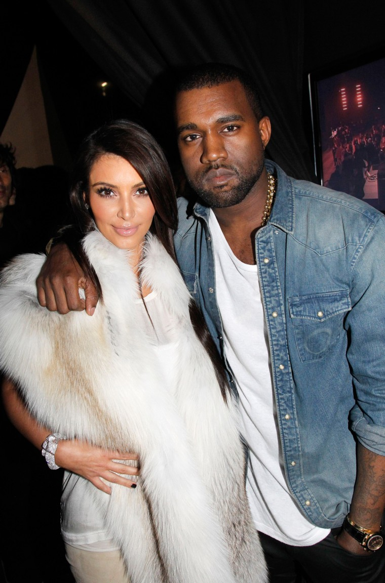 Kanye West, seen here with Kim Kardashian at Paris Fashion Week 2012, now admits he was in love with her.