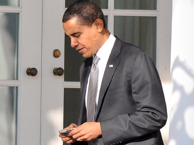 President Barack Obama uses his BlackBerry near the Oval Office at the White House in 2009.