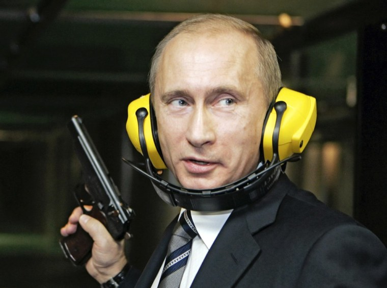 Russian leader Vladimir Putin stands with a gun at a shooting gallery of the new GRU military intelligence headquarters building in Moscow during a 2006 visit. Last month, Putin said nations would eventually develop new types of weapons, including