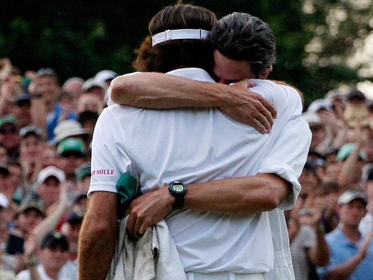 Bubba Watson (right) of the United States hugs his caddie Ted Scott after winning his sudden death playoff on the second playoff hole to win the 2012 Masters Tournament by one stroke at Augusta National Golf Club on April 8, 2012 in Augusta, Georgia.