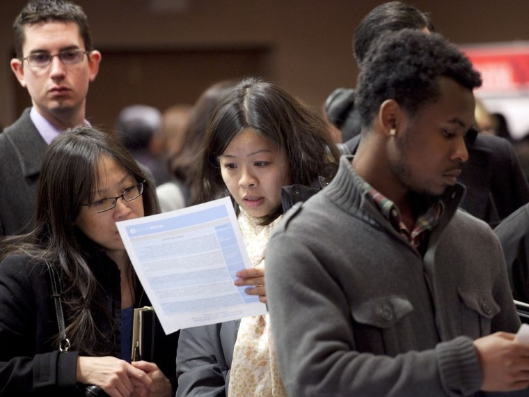 People wait to talk with potential employers at a job fair in New York last December. Despite the high jobless rate, some say it's hard to find good workers.