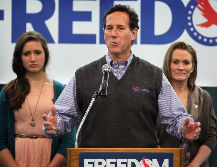 Rick Santorum rocks the sweater vest while speaking during a campaign rally on April 1, 2012 in Mishicot, Wis.