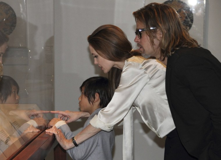 Angelina Jolie wears her engagement ring as she and fiance Brad Pitt and their son Pax view works from the Los Angeles County Museum of Art's Chinese collection on  Wednesday, April 11.