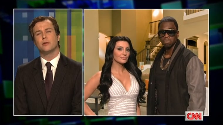 "Taran Killam played Piers Morgan, with Jay Pharaoh as Kanye West and Nasim Pedrad as Kim Kardashian on \""Saturday Night Live.\"""