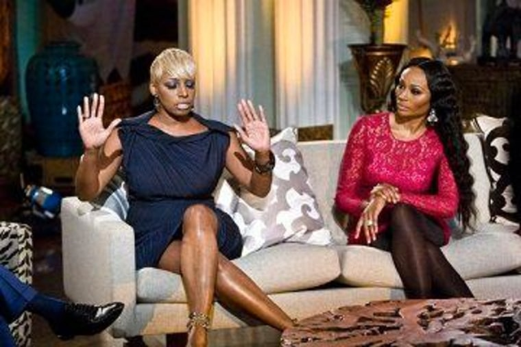 """Cynthia Bailey looks on as NeNe Leakes finds herself in the middle of the latest \""""Real Housewives of Atlanta\"""" drama."""
